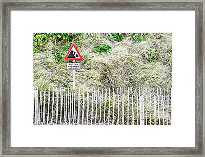 Cliff Warning Framed Print by Tom Gowanlock