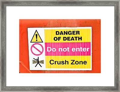 Danger Sign Framed Print by Tom Gowanlock