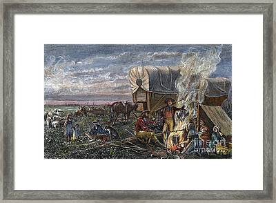 Emigrants To The West Framed Print by Granger
