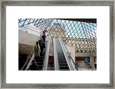 Escalator Entrance To Louvre Framed Print by Carl Purcell
