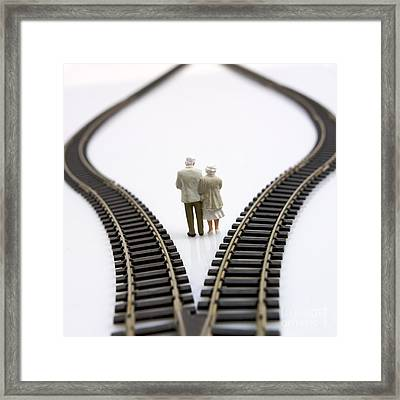 Figurines Between Two Tracks Leading Into Different Directions Symbolic Image For Making Decisions. Framed Print