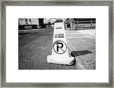garda no parking traffic cones on a street in Clones county monaghan republic of ireland Framed Print by Joe Fox