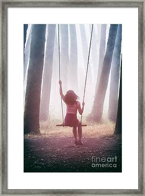 Girl In Swing Framed Print by Carlos Caetano