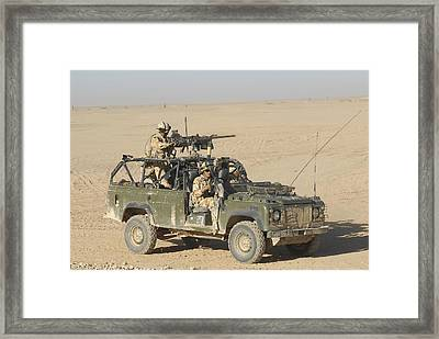 Gurkhas Patrol Afghanistan In A Land Framed Print by Andrew Chittock