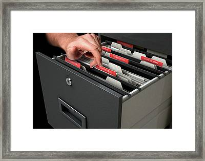 Hand Looking Though Filing Cabinet Drawer Framed Print