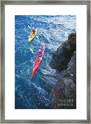 Kayaking Along Coastline Framed Print by Ron Dahlquist - Printscapes