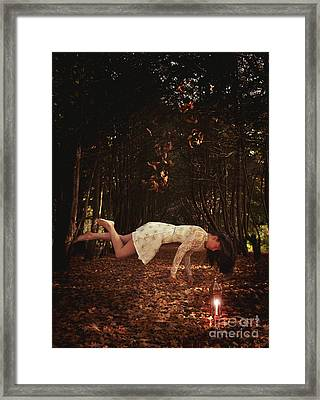 Levitation With Lamp Framed Print
