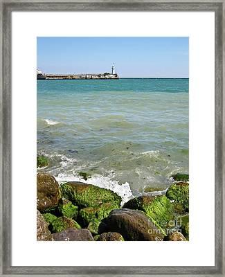 Lighthouse In Sea Framed Print