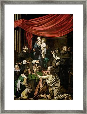Madonna Of The Rosary Framed Print by Caravaggio