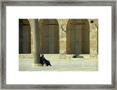 Man Sitting Inside The Great Mosque Of Aleppo Framed Print by Sami Sarkis