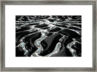 Molten Silver Seeping Out Of Rock Framed Print