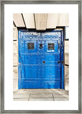 Old Blue Door Framed Print by Tom Gowanlock