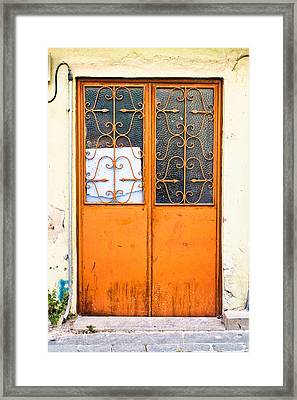 Orange Door Framed Print by Tom Gowanlock
