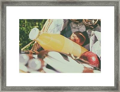 Picnic Basket With Orange Juice Bottle, Apples, Peaches, Oranges And Croissants On Green Grass Framed Print