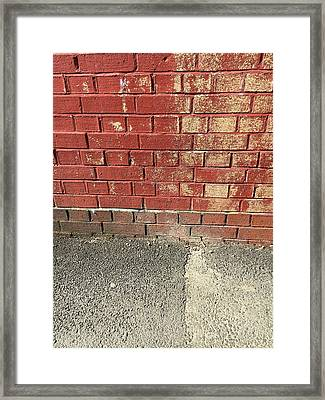 Red Brick Wall Framed Print by Tom Gowanlock