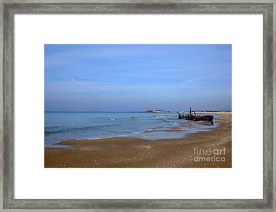 Rusty Abandoned Beached Ship  Framed Print by Ofer Zilberstein