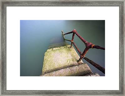 Rusty Handrail Going Down On Water Framed Print