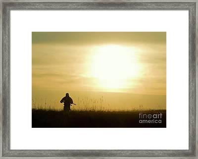 Silhouette Of Soldier Framed Print by Oleg Zabielin