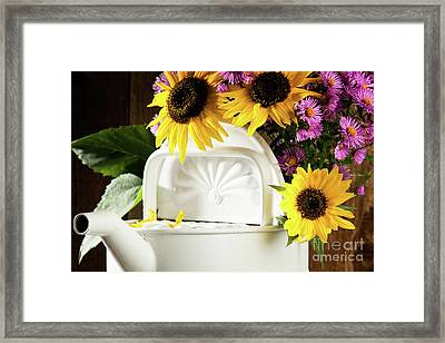 Sunflowers And Asters In A Watering Can Framed Print by Wolfgang Steiner