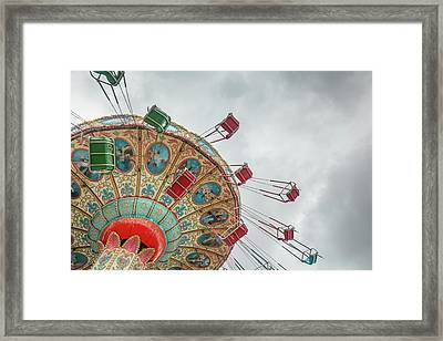 Swings In Motion With Stormy Sky Framed Print by Erin Cadigan