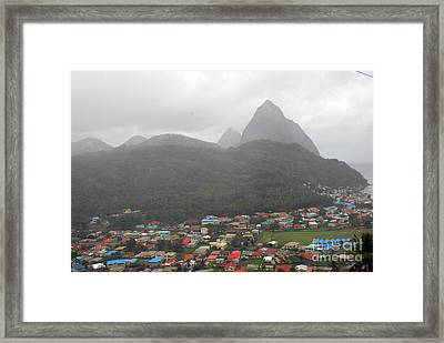 Framed Print featuring the photograph The Pilons by Gary Wonning
