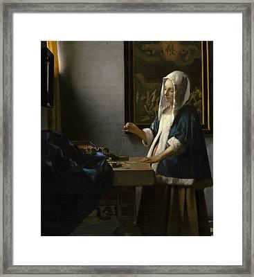 Woman Holding A Balance Framed Print