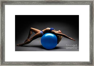 Woman On A Ball Framed Print by Oleksiy Maksymenko