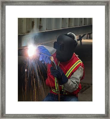 Worker Work Hard With Welding Process  Framed Print by Anek Suwannaphoom