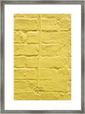 Yellow Brick Wall Framed Print by Tom Gowanlock