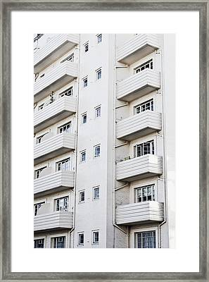 Apartment Building Framed Print by Tom Gowanlock
