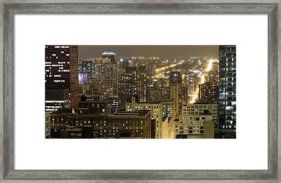 Buildings In A City Lit Up At Night Framed Print by Panoramic Images