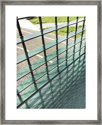 A Metal Fence Framed Print by Tom Gowanlock