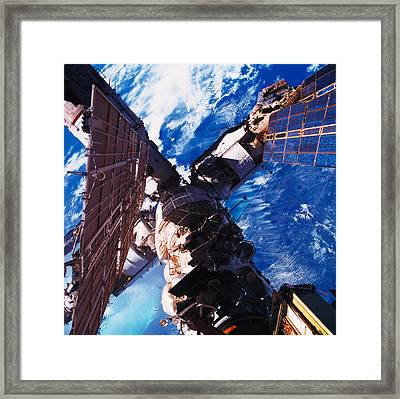A Space Station Orbiting Above The Earth Framed Print by Stockbyte