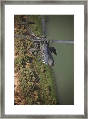 An Ah-64d Apache Helicopter In Flight Framed Print by Terry Moore