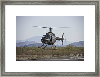An Oh-58 Kiowa Helicopter Of The U.s Framed Print by Terry Moore