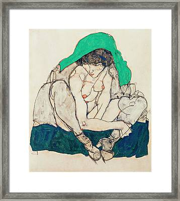 Crouching Woman With Green Headscarf Framed Print