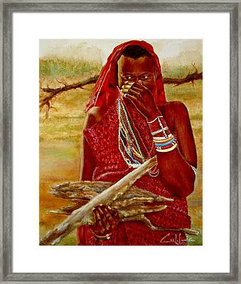 Girl With Sticks Framed Print