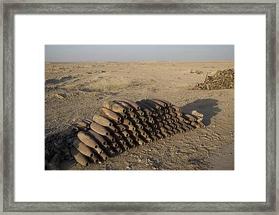 Inert Artillery Shells Are Stacked Framed Print by Terry Moore
