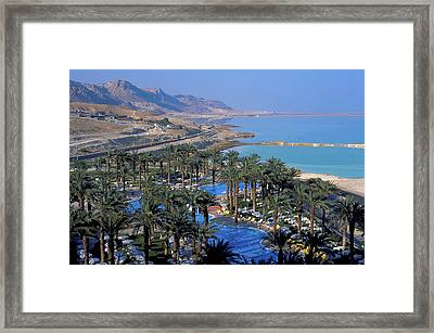 Luxury Resort On The Dead Sea Framed Print by Carl Purcell