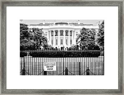 security fence and restricted area signs at the south facade of the white house Washington DC USA Framed Print