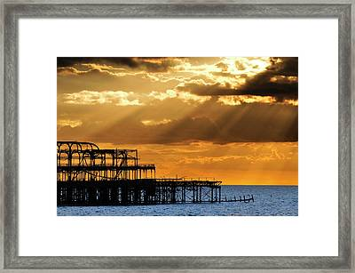 The West Pier In Brighton At Sunset Framed Print