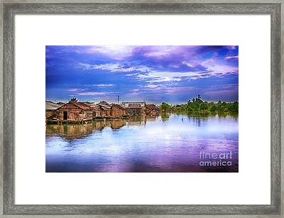 Framed Print featuring the photograph Village by Charuhas Images