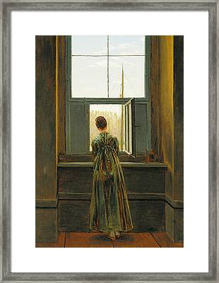 Woman At A Window Framed Print by Caspar David Friedrich