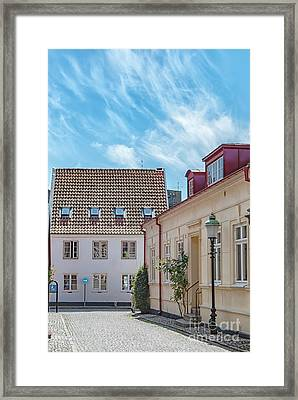 Framed Print featuring the photograph Ystad Street Scene by Antony McAulay