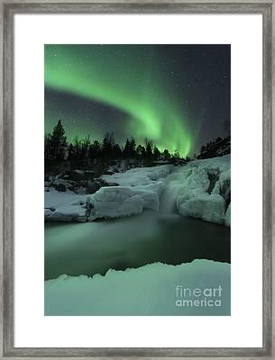 A Wintery Waterfall And Aurora Borealis Framed Print by Arild Heitmann