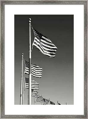 American Flag Waving In The Wind Framed Print