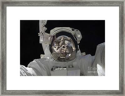Astronaut Uses A Digital Still Camera Framed Print