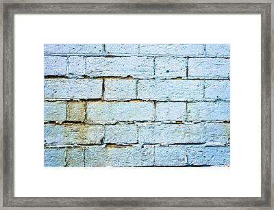 Blue Brick Wall Framed Print by Tom Gowanlock