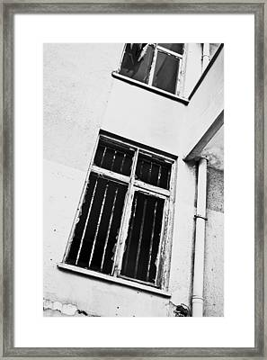 Broken Window Framed Print
