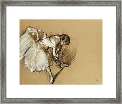 Dancer Adjusting Her Shoe Framed Print